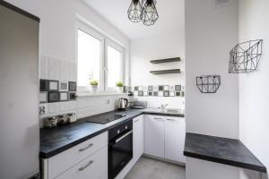 Zlota z dwoma sypialniami, Apartmanok  Varsó - big - 11