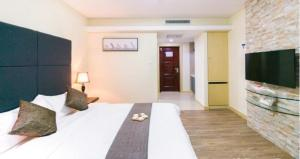 Estay ApartHotel Weihai Jinsha International, Residence  Weihai - big - 8