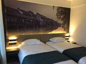 Tongxiang Wuzhen Shangjin Hotel, Отели  Wujiaqiao - big - 8