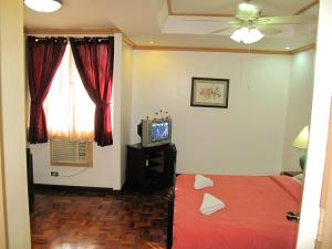 Makati Suites at Travelers Inn, Apartmánové hotely  Manila - big - 14
