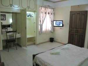 Makati Suites at Travelers Inn, Apartmánové hotely  Manila - big - 65