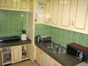 Makati Suites at Travelers Inn, Apartmánové hotely  Manila - big - 24
