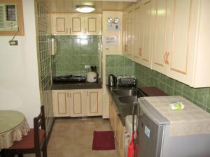 Makati Suites at Travelers Inn, Apartmánové hotely  Manila - big - 28