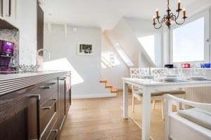 _Kuerzdoerfers_ App_ 3 OG, Apartmanok  Wenningstedt - big - 8