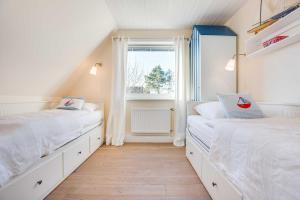 _Kuerzdoerfers_ App_ 3 OG, Apartmanok  Wenningstedt - big - 16