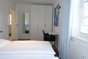 Suederwung 12 _ Appartement 1, Apartmanok  Wenningstedt - big - 3