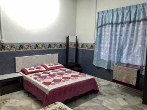 Homestay Banglo D'Tampin, Privatzimmer  Tampin - big - 24