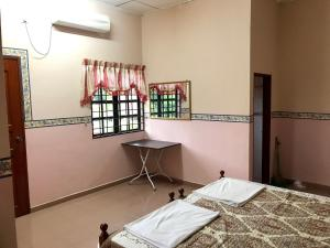 Homestay Banglo D'Tampin, Privatzimmer  Tampin - big - 17
