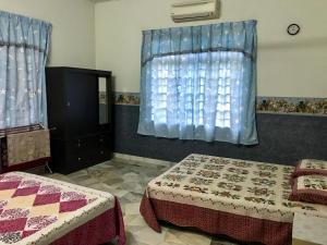 Homestay Banglo D'Tampin, Privatzimmer  Tampin - big - 23