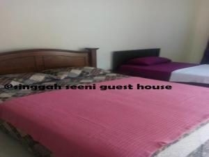 Singgah Seeni Guest House, Гостевые дома  Кампунг-Паданг-Масират - big - 14