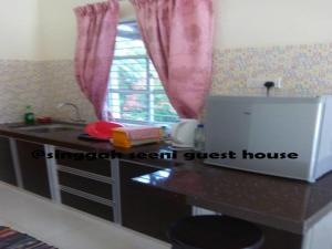 Singgah Seeni Guest House, Гостевые дома  Кампунг-Паданг-Масират - big - 13