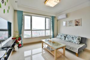 Mile Family Apartment, Apartmány  Weihai - big - 9