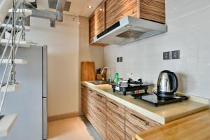 Mile Family Apartment, Apartmány  Weihai - big - 15