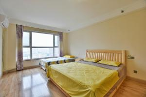 Mile Family Apartment, Apartmány  Weihai - big - 18
