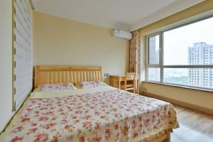Mile Family Apartment, Apartmány  Weihai - big - 20