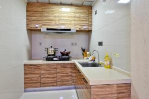 Mile Family Apartment, Apartmány  Weihai - big - 21