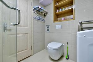 Mile Family Apartment, Apartmány  Weihai - big - 24