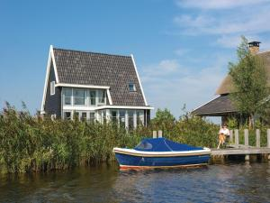 Holiday Home Bodelaeke-Wiedenwoning, Ferienhäuser  Giethoorn - big - 5