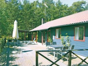 Holiday home Hakkebakkeskogen Nexø I