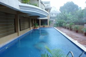 Apartment room with a shared pool, by GuestHouser, Apartments  Saligao - big - 4