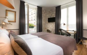 Париж - Hotel Jeanne d'Arc Le Marais