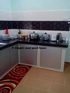 Singgah Seeni Guest House, Гостевые дома  Кампунг-Паданг-Масират - big - 10