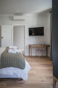 Rozenhof Guest Accommodation, Гостевые дома  Стелленбос - big - 21