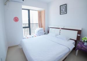 Senran (Xinjiayuan) Apartment, Апартаменты  Чжухай - big - 48
