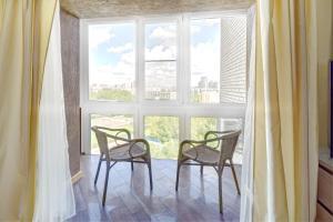 Apartments on Tihoretskiy Prospekt, Ferienwohnungen  Sankt Petersburg - big - 10