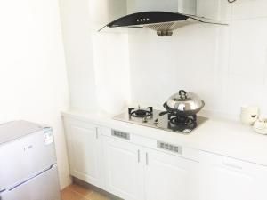 Senran (Xinjiayuan) Apartment, Апартаменты  Чжухай - big - 92