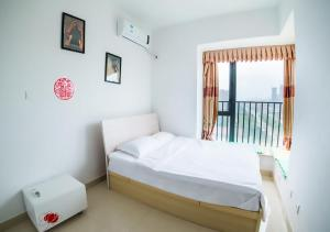 Senran (Xinjiayuan) Apartment, Апартаменты  Чжухай - big - 82