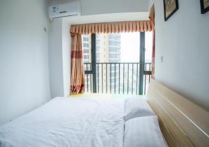 Senran (Xinjiayuan) Apartment, Апартаменты  Чжухай - big - 80