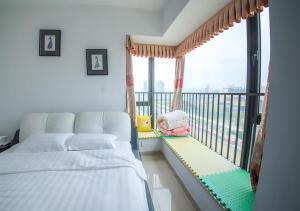 Senran (Xinjiayuan) Apartment, Апартаменты  Чжухай - big - 78