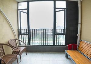 Senran (Xinjiayuan) Apartment, Апартаменты  Чжухай - big - 77
