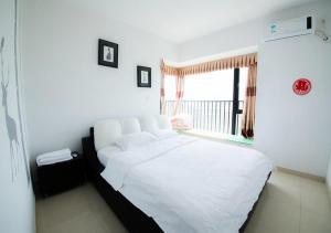 Senran (Xinjiayuan) Apartment, Апартаменты  Чжухай - big - 76