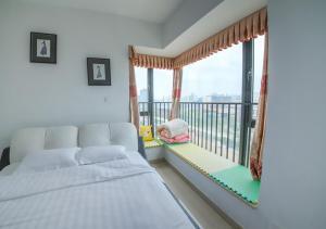 Senran (Xinjiayuan) Apartment, Апартаменты  Чжухай - big - 74