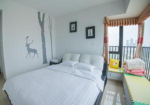 Senran (Xinjiayuan) Apartment, Апартаменты  Чжухай - big - 73