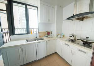Senran (Xinjiayuan) Apartment, Апартаменты  Чжухай - big - 72
