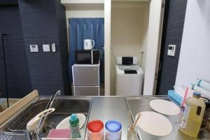 AH Apartment in Tokaichimachi 2546, Апартаменты  Хиросима - big - 6