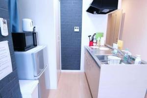 AH Apartment in Tokaichimachi 2546, Апартаменты  Хиросима - big - 21