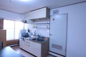 AH Apartment in Higashikaniyacho 2680, Апартаменты  Хиросима - big - 6