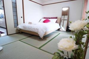 AH Apartment in Higashikaniyacho 2680, Апартаменты  Хиросима - big - 11