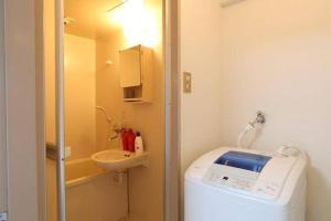 AH Apartment in Higashikaniyacho 2680, Апартаменты  Хиросима - big - 37