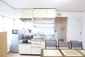AH Apartment in Higashikaniyacho 2680, Апартаменты  Хиросима - big - 46