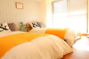 Hiroshima Peace Park House 502, Апартаменты  Хиросима - big - 13