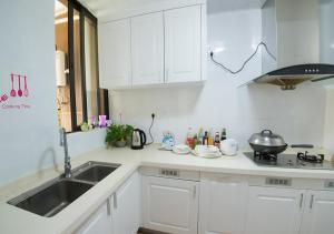 Senran (Xinjiayuan) Apartment, Апартаменты  Чжухай - big - 32