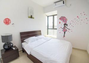 Senran (Xinjiayuan) Apartment, Апартаменты  Чжухай - big - 64