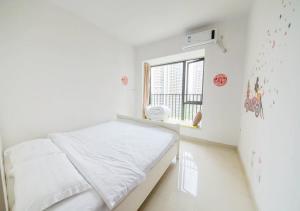Senran (Xinjiayuan) Apartment, Апартаменты  Чжухай - big - 63