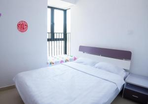 Senran (Xinjiayuan) Apartment, Апартаменты  Чжухай - big - 57