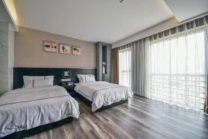 K Family Boutique Short-Term Hotel(Dali Gold K Sea View Branch), Hotels  Dali - big - 30